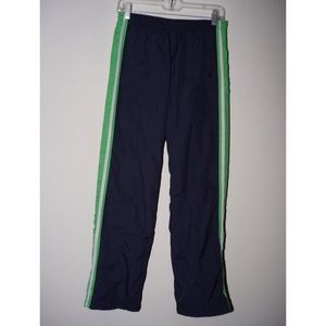 Navy blue athletic pants, green/white side stripe